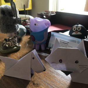 Origami Cat and Origami Dog surrounded by stuff